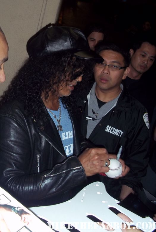 Guns n roses star and lengend slash signs autographs for fans after an outdoor concert rare promo hot musician