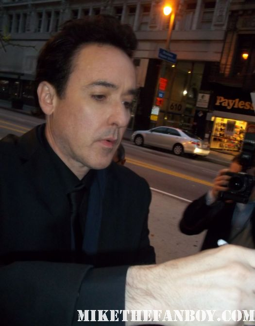 john cusack signing autographs for fans at the world premiere of the raven in los angeles sexy john cusak hot tub time machine