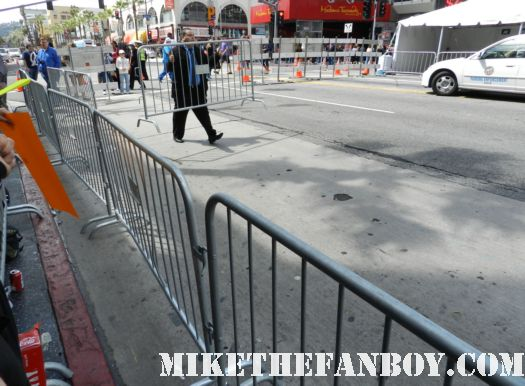 the crowd waiting at the avengers world movie premiere fan barricades on the red carpet with chris hemsworth chris evans samuel l jackson and more