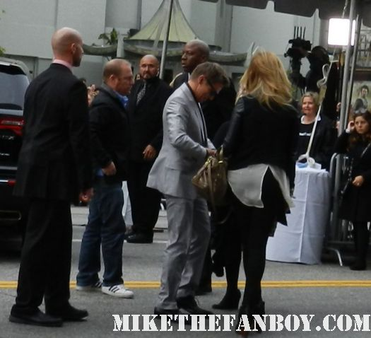 sexy jeremy renner hawkeye  signs autographs for fans at the avengers world movie premiere on the red carpet with chris hemsworth chris evans samuel l jackson and more