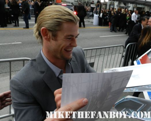 sexy chris hemsworth thor signs autographs for fans at the avengers world movie premiere on the red carpet with chris hemsworth chris evans samuel l jackson and more