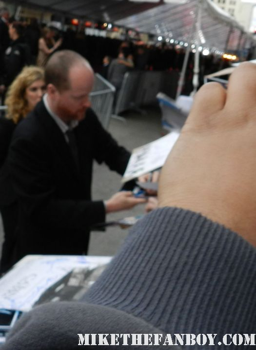 buffy the vampire slayer creator joss whedon signs autographs for fans at the avengers world movie premiere on the red carpet with chris hemsworth chris evans samuel l jackson and more