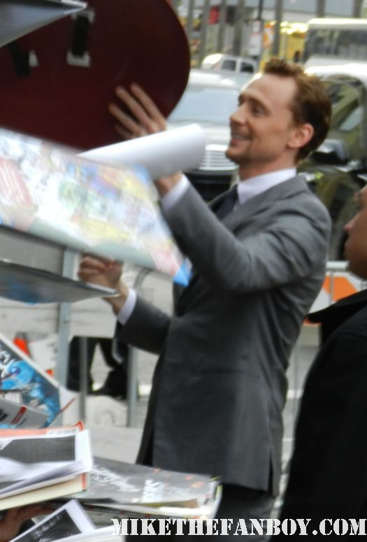 tom hiddleston signs autographs for fans at the avengers world movie premiere on the red carpet with chris hemsworth chris evans samuel l jackson and more