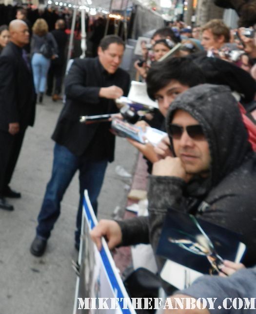jon favreau signs autographs for fans at the avengers world movie premiere on the red carpet with chris hemsworth chris evans samuel l jackson and more