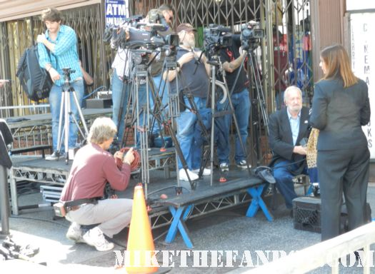 larry edmunds bookstore in hollywood with a display for the raven with john cusack A wolf running down Hollywood blvd setting up the stage for john cusack walk of fame star ceremony on hollywood blvd rare promo stage red carpet