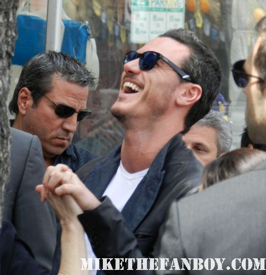 sexy luke evans arriving to john cusack's walk of fame star ceremony on hollywood blvd