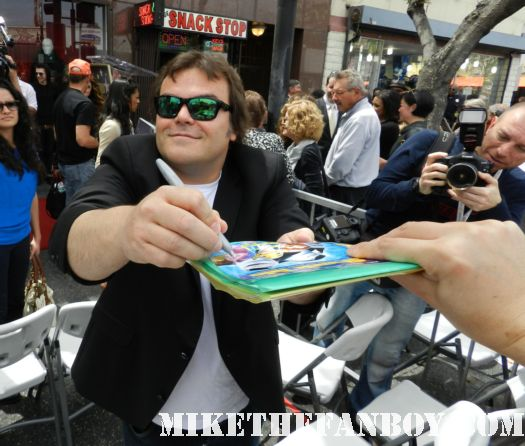 jack black signing autographs at john cusack's walk of fame star ceremony John Cusack getting honored on the hollywood walk of fame  john cusack's walk of fame star ceremony on hollywood blvd