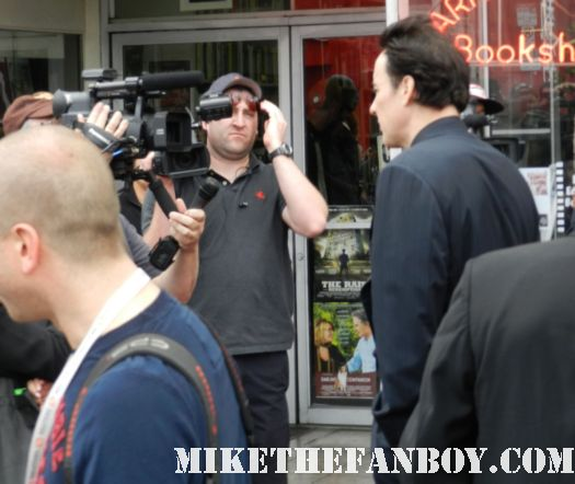 john cusack giving a press interview at his walk of fame star ceremony on hollywood blvd.