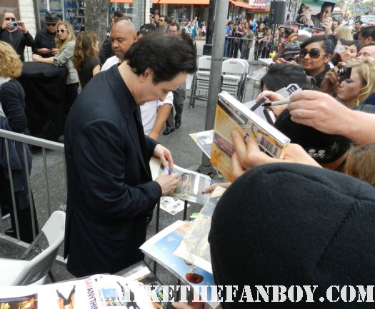 john cusack signing autographs at his walk of fame star ceremony in hollywood john cusack giving a press interview at his walk of fame star ceremony on hollywood blvd.