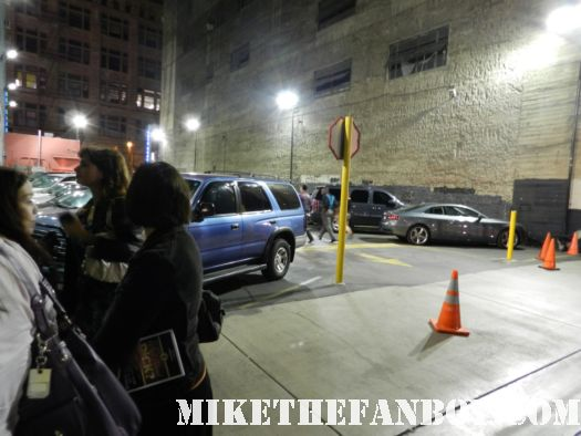 people waiting in the back of the orpheum theatre the orpheum theatre downtown los angeles marquee for what about dick eric idle's new play with russell brand and tim curry