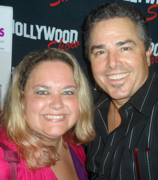 Christopher Knight (aka Peter Brady) taking a fan photo at the hollywood collector's show in burbank