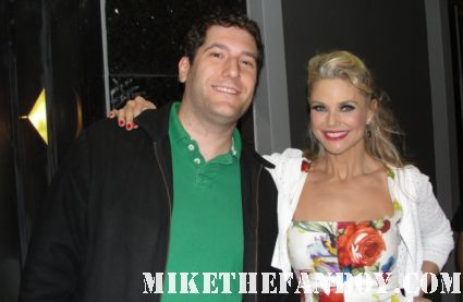 mike the fanboy poses with national lampoon's vacation star christie brinkley after a performance of chicago