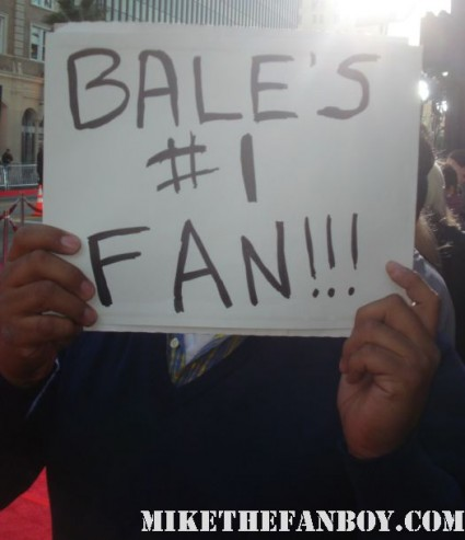 christian bale's number one fan sign cb holds it up at the fighter world movie premiere