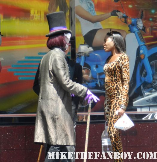 the costumed characters on hollywood blvd including willy wonka and catwoman waiting at the dark shadows premiere