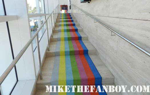 rainbow carpet leading up to a television set with color bars at the paley centers out of the box exhibit in beverly hills