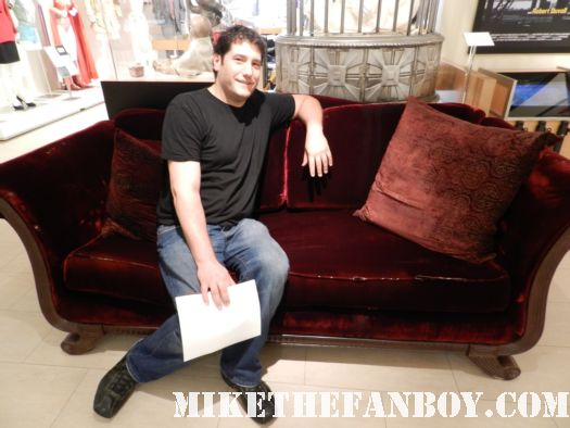 mike the fanboy sitting on bill compton's couch prop from home queen's remains queen sophie anne's costume and cage prop and costume the creepy baby doll prop from true blood true blood prop vials of v and talbots remains on display at the paley center out of the box costume and prop display