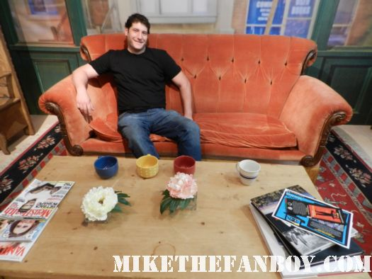 mike the fanboy sitting on the couch on the recreation of the friends set at the paley center out of the box prop and costume display in beverly hills