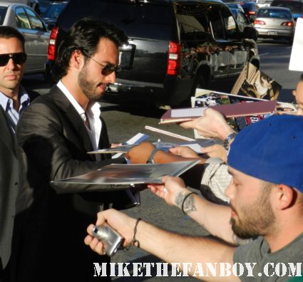 Rodrigo Santoro signing autographs for fans at the what to expect when you're expecting world movie premiere red carpet with cameron diaz jennifer lopez matthew morrison chace crawford
