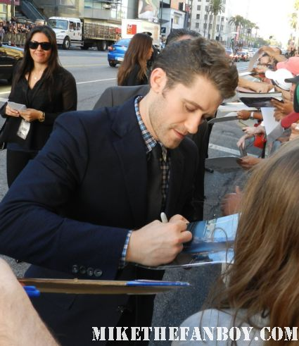 Matthew morrison from Glee signing autographs for fans at the what to expect when you're expecting world movie premiere hot