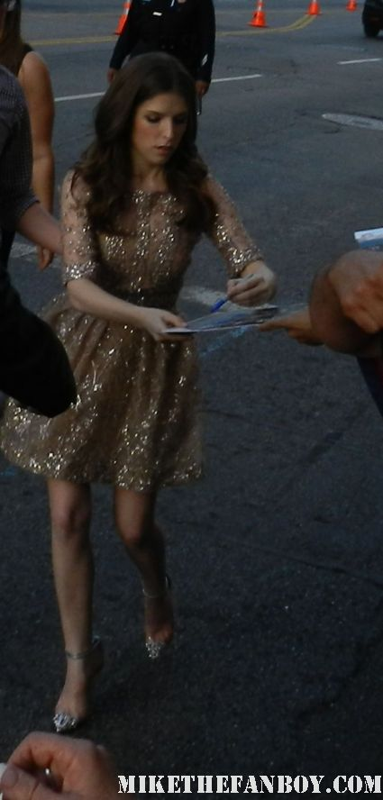 anna kendrick signing autographs for fans at the  what to expect when you're expecting world movie premiere
