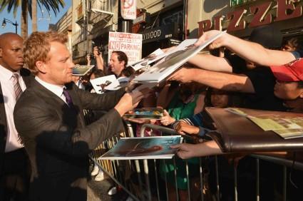 "World Premiere Of Disney Pixar's ""Brave"" - Red Carpet kevin mckidd signing autographs for fans at the brave movie premiere"