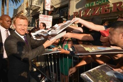 "World Premiere Of Disney Pixar's ""Brave"" - Red Carpet kevin mckidd signing autographs for fans at the brave movie premiere"