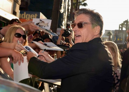 "World Premiere Of Disney Pixar's ""Brave"" - Red Carpet craig ferguson signing autographs for fans at the brave movie premiere"