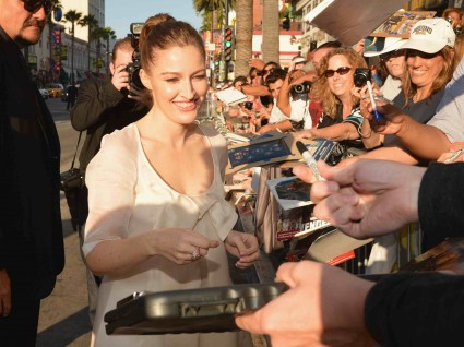 "World Premiere Of Disney Pixar's ""Brave"" - Red Carpet sexy kelly macdonald signing autographs for fans at the brave movie premiere"