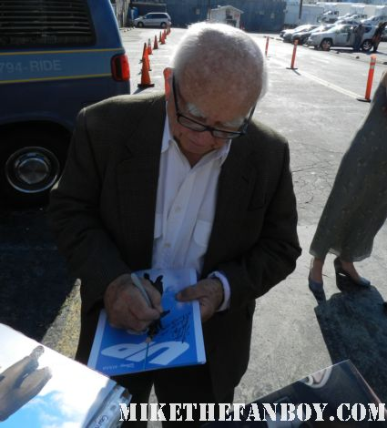 television legend Ed Asner signs autographs for fans at the young playwright's festival in los angeles