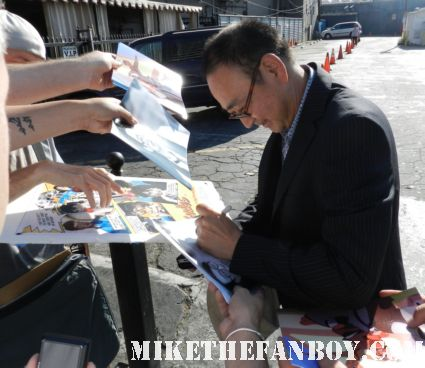 Gedde Watanabe aka long duck dong from 16 candles signs autographs for fans in hollywood at the young playwrights festival