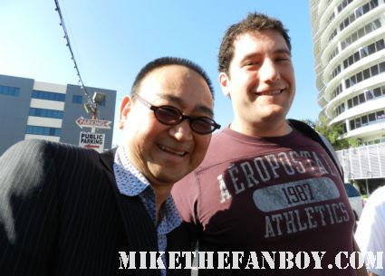 Gedde Watanabe aka long duck dong from 16 candles poses with Mike The Fanboy for a fan photo signs autographs for fans in hollywood at the young playwrights festival