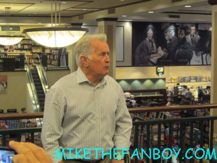 Martin Sheen beginning his book signing for Along the way: A journey of father and son in thousand oaks CA autograph