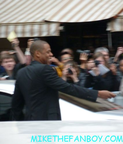 jay-z  signing autographs  to the uk premiere of men in black III 3 men in black dancers the men in black III 3 uk movie premiere red carpet with will smith josh brolin emma thompson and more
