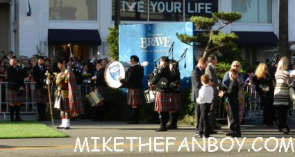 fans waiting at the world premiere of walt disney's brave in hollywood craig ferguson signing autographs for fans at the world premiere of brave in hollywoodbag pipe players at walt disney's world premiere of brave pixar rare red carpet scottish animated classic