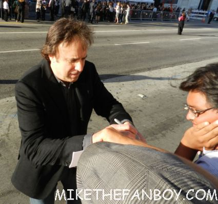 weeds star kevin nealon signing autographs for fans at the world premiere of brave in hollywoodbag pipe players at walt disney's world premiere of brave pixar rare red carpet scottish animated classic