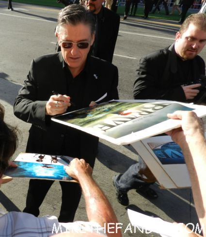 craig ferguson signing autographs for fans at the world premiere of brave in hollywoodbag pipe players at walt disney's world premiere of brave pixar rare red carpet scottish animated classic