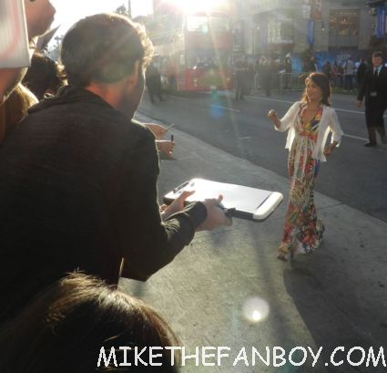 Ming-Na signing autographs for fans at the world premiere of walt disney's brave in hollywood craig ferguson signing autographs for fans at the world premiere of brave in hollywoodbag pipe players at walt disney's world premiere of brave pixar rare red carpet scottish animated classic