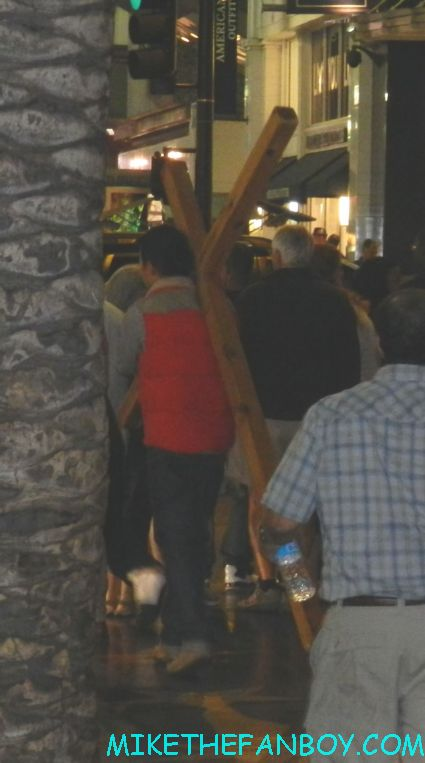 a man walking down hollywood blvd with a giant wooden cross as we are waiting for firefly and serenity star sean maher