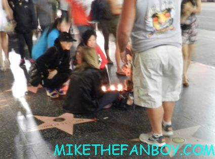 a group of women having a seance on hollywood blvd. crazy people hanging around on hollywood blvd. bag of underwear for homeless people sitting on hollywood blvd waiting for firefly star sean maher