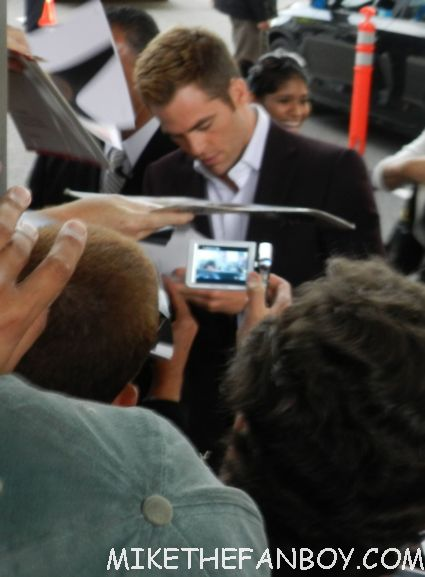 sexy chris pine signing autographs at  the world premiere of people like us world movie premiere at the la film festival in downtown los angeles michelle pfeiffer chris pine elizabeth banks