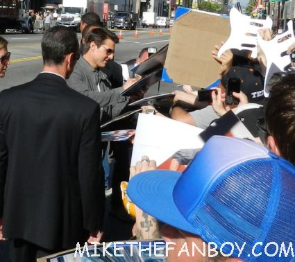 tom cruise signing autographs for fans looking hot and sexy at the rock of ages world movie premiere