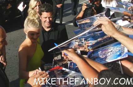 Julianne Hough signing autographs for fans looking hot and sexy at the rock of ages world movie premiere