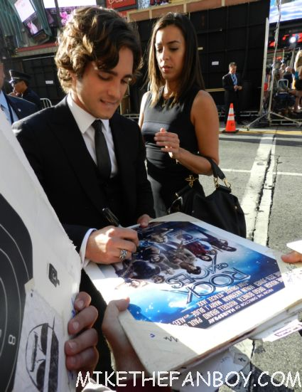 sexy Diego Boneta signing autographs for fans looking hot and sexy at the rock of ages world movie premiere