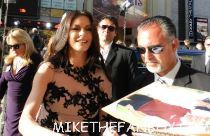 sexy catherine zeta jones signing autographs for fans looking hot and sexy at the rock of ages world movie premiere