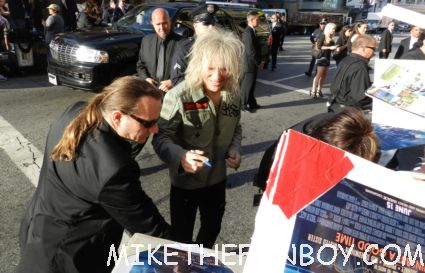 sexy bret michaels from poison signing autographs for fans looking hot and sexy at the rock of ages world movie premiere