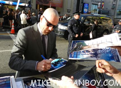 breaking bad star bryan cranston signing autographs for fans looking hot and sexy at the rock of ages world movie premiere