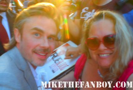 pretty in pinky getting a photo with true blood star sam trammell at the season 5 world premiere in hollywood