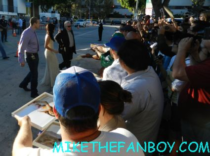 Sandra Echeverria signing autographs for fans at the savages world movie premiere in westwood ca