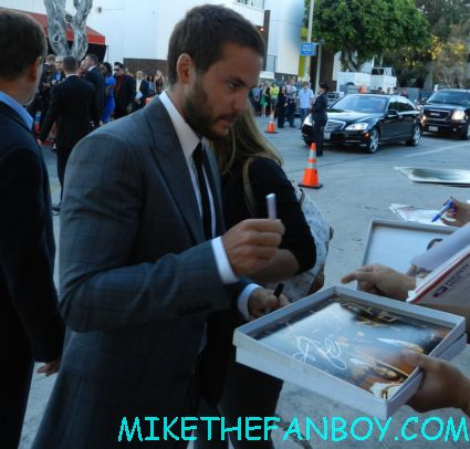 sexy Taylor Kitsch signing autographs at the savages world movie premiere john carter covenant battleship rare sexy friday night lights star