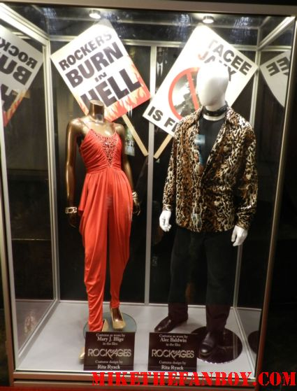 Rock of Ages prop and costume display at the arclight Hollywood with alec baldwin and mary j blige's costumes props rare